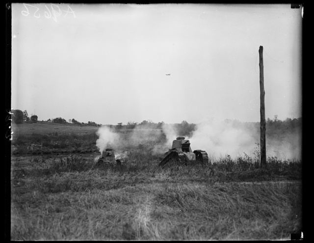 Scene showing tanks in action during the mimic battle staged at Camp Franklin, Md., May 12, by the U.S. Tank Corps for the graduating class of the Army War College. Real ammunition was used by all the attacking forces