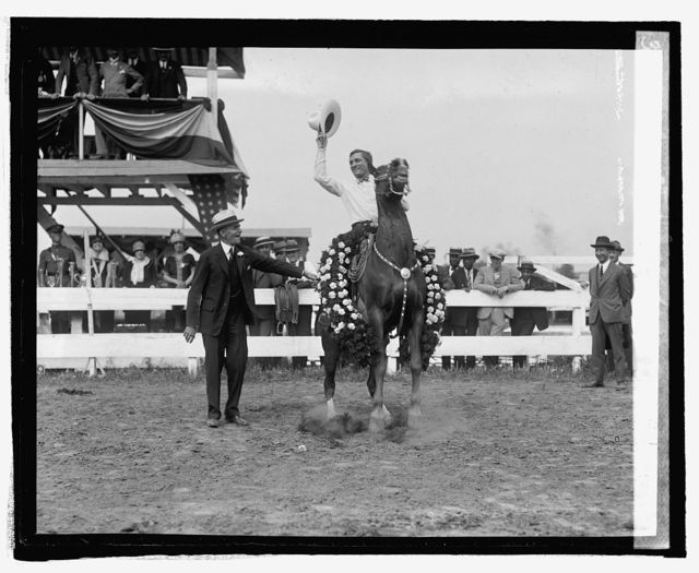 Secty. Jardine and Tom Mix at horse show, [5/21/25]