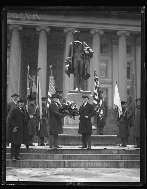 Secy. of Treasury Mellon laying wreath on statue of Alex. Hamilton in behalf of Sons of the Amer. Revolution, Jan. 10, in commemoration of the 1st Treasury Secy.'s 168th birthday
