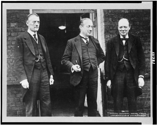 [Standing, left to right: Mr. Austen Chamberlain, Premier Stanley Baldwin, and Sir Winston Churchill] / Photo Central News from Underwood & Underwood.