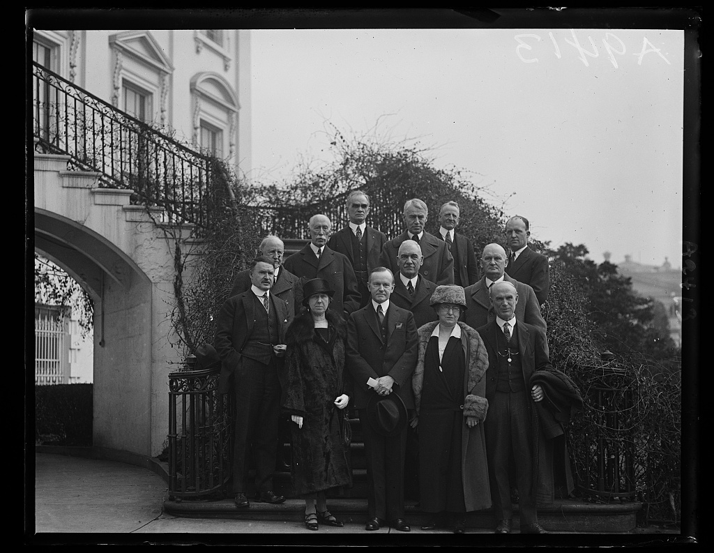 The first meeting of the commission to arrange for the celebration of the 200th anniversary of the birth of George Washington to be held in 1932, took place today, Feb. 16th at the White House with President Coolidge as chairman. The committee includes four members appointed by the Senate, four from the House and four appointed by the President. Left to right, front row: Senator Selden P. Spencer, Missouri; Mrs. Anthony Wayne Cook, President General, D.A.R.; President Coolidge; Mrs. John D. Sherman, Federation of Women's Clubs and Senator Simeon Fess, Ohio. Second row: Frederick H. Gillett, Speaker of the House of Representatives; Representative John Q. Tilson, Connecticut; Representative Willis C. Hawley, Oregon. Top row: Frank Munsey, publisher; Representative Joseph W. Byrns, Tennessee; Senator Thomas F. Bayard, Delaware; Senator Carter Class, Virginia, and Hanford Monider, former Commander of the American Legion
