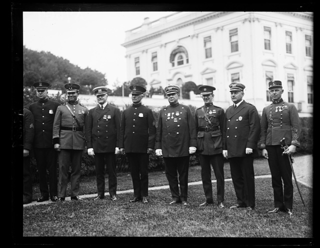 These men whose names throw fear into the hearts of criminals in their respective countries paid their respects to President Coolidge, May 25th. They are, (left to right) [...] Alcantara, Honduras, Inspector J. O'Conner, New York City; [...] L. Walter, White House Police, Inspector General C.H. McKinney [...] New York City; General Eoin O'Duffy, Ireland, Captain John J. [...]'Connell, New York City and John Bingert, Budapest Hungary