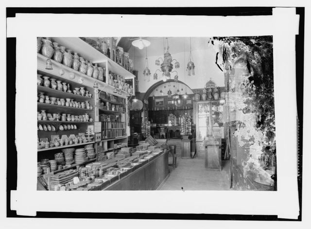 Typical oriental store, faience and brass articles.