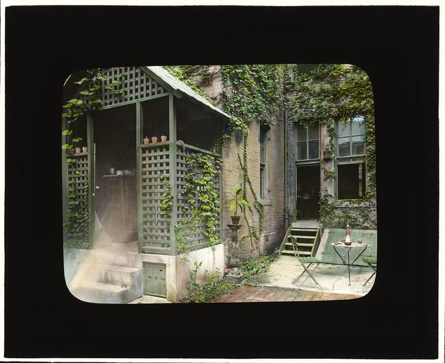 [William Windom house, 1723 de Sales Place, Washington, D.C. Terrace with garden table by pantry]