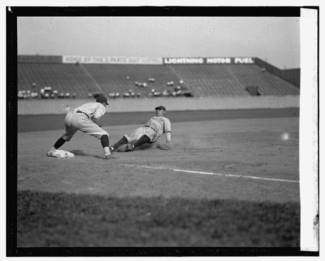 [Yankees Babe Ruth safe at third in fourth inning on Bob Meusel's fly out. Senators third baseman is Ossie Bluege. Senators won 8-1