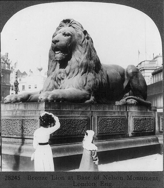 Bronze lion at base of Nelson Monument, London, Eng.