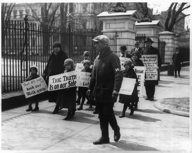 [Four adults and six children, from Passaic, N.J., picket the White House following President Coolidge's refusal to listen to their complaints about wage cuts in the textile industry]