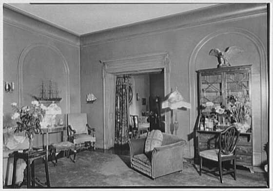 George St. George, residence in Tuxedo Park, New York. Corner living room vista to other living room
