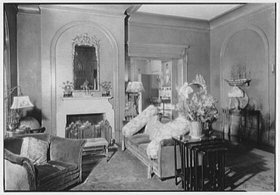 George St. George, residence in Tuxedo Park, New York. Fireplace living room vista to dining room