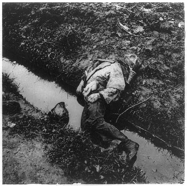 [German corpse in water-filled trench. Belgium. ca. 1917]