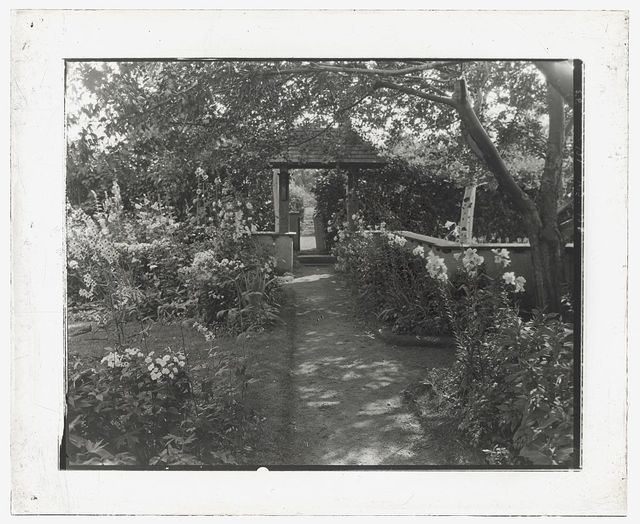 "[""Indian Ridge,"" Dr. Francis Bishop Harrington house, 166 Argilla Road, Ipswich, Massachusetts. Pathway to garden seat]"