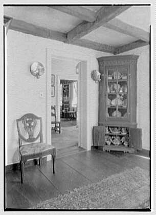 Mrs. A.F. Tiffany, residence on E. Norwich Rd., Oyster Bay, Long Island. Cupboard and vista through doorway