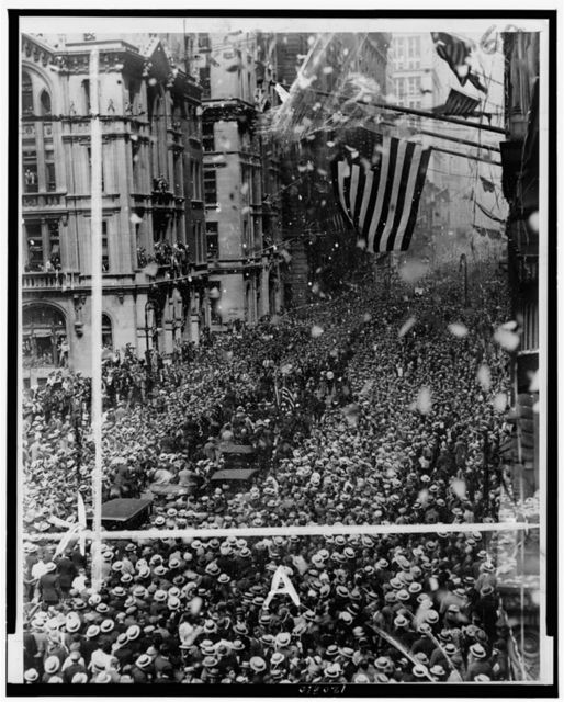 [Parade for Gertrude Ederle coming up Broadway, New York City, with large crowd watching] / photo by staff photographer.