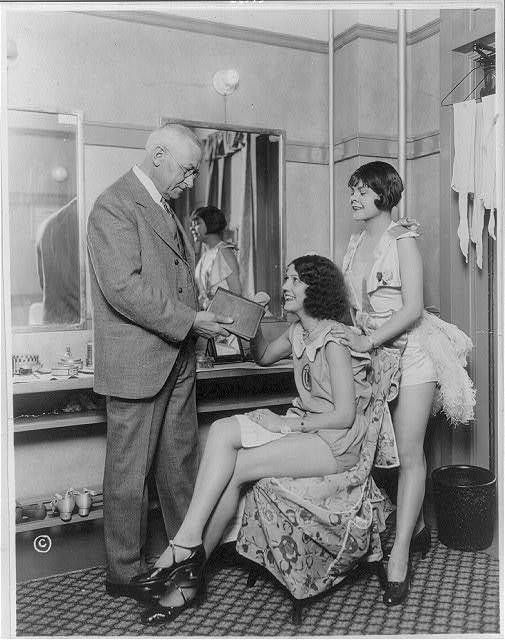 A member of the Gideons, an organization of men who place Bibles in hotels and elsewhere, leaving a copy with two dancers [in their dressing room]