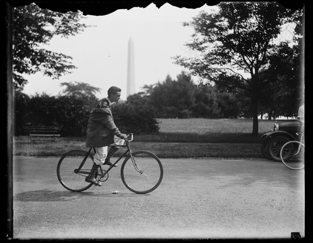 [Bicycle rider;Washington Monument in background, Washington, D.C.]