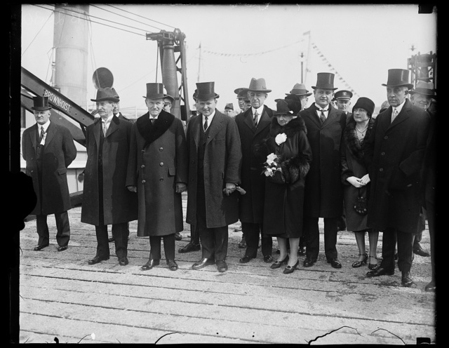 [Claude Swanson, Calvin Coolidge and group at waterfront]