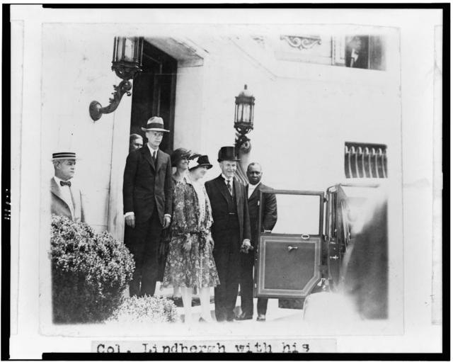 Col. Linbergh[sic] with his mother and President and Mrs. Coolidge leaving the temperary[sic] White House