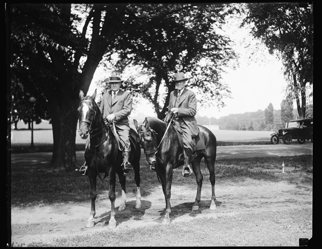 """""""Daddy"""" of Assistant Secretary of Agriculture is expert horseman at 84. Although he has passed his 84th birthday, Nelson J. Dunlap, (right) father of the Assistant Secretary of Agriculture, Renick Dunlap (left) rides horseback for his daily exercise. The elder Dunlap is a Civil War veteran and a native of Kingston, Ohio, where he is a large land owner"""