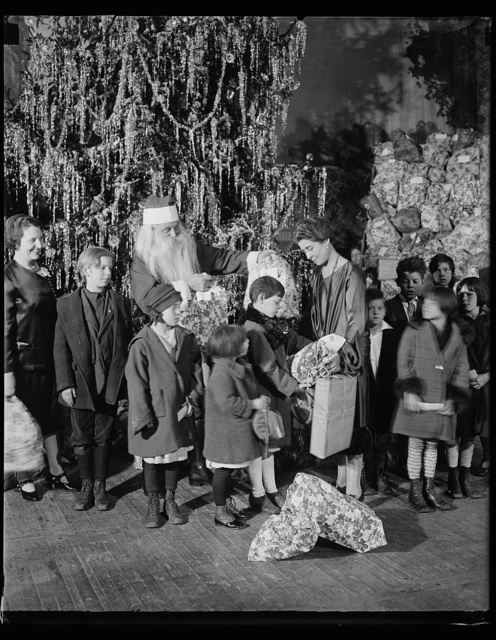 [Grace Coolidge, Santa Claus, and children next to Christmas tree]