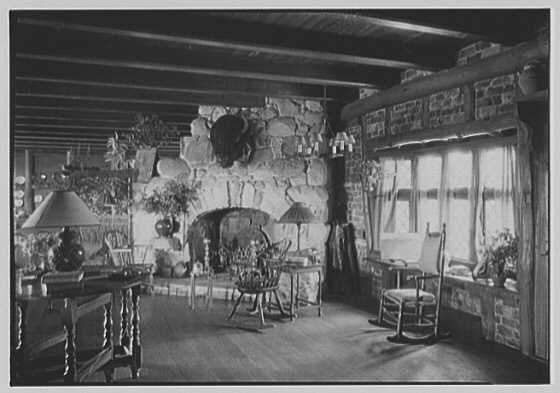 Grosvenor Atterbury, residence in Shinnecock Hills, Long Island, New York. Stone fireplace, natural light