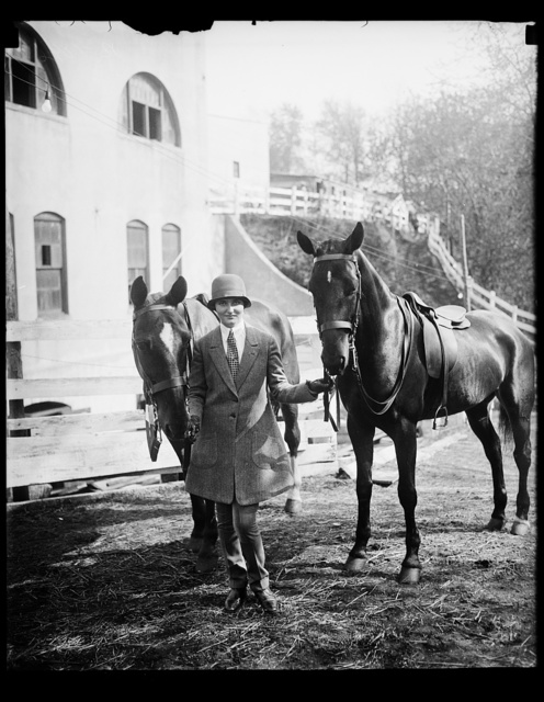 "In spotlight at opening of Washington Horse Show. Mary Parker Corning, daughter of Representative and Mrs. Parker [...]rning of New York, with ""Red"" and ""Joy"", her favorite thoroughbreds at the opening of the Washington Horse Show today"