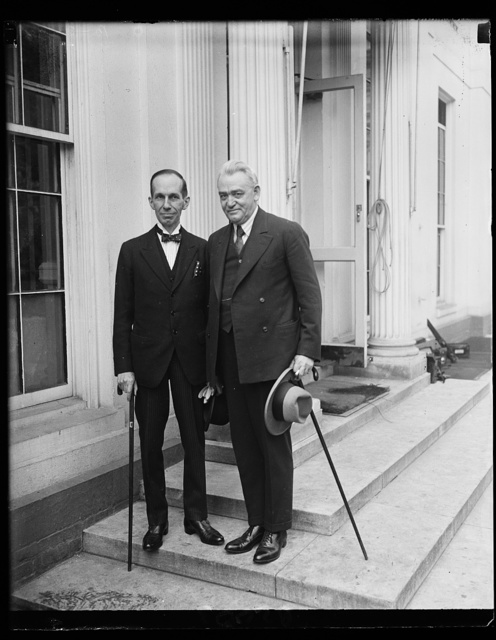 Interesting callers at White House. [...] J.R. King, (right) Director of Public Health for Canada, [...]sented to President Coolidge at the White House today by [...]dian Minister, Vincent Massey, shown on the left