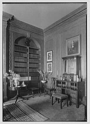 Marshall Field, residence in Huntington, Long Island, New York. Detail, library with desk, natural light