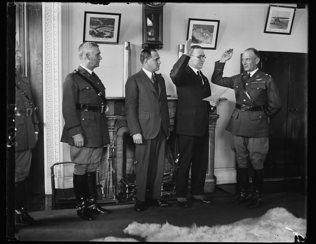 New Air Corps Chief takes oath of office. Maj. Gen. James F. Fechet being sworn in as Chief of the Army Air Corps to succeed Maj. Gen. Mason M. Patrick, retired. In the photograph, left to right; Maj. Charles P. Summerall, Chief of Staff. F. Trubee Davison, Assistant Secretary of War for Aviation; Lieut, Col. Joseph I. McMullen, a boyhood friend of Gen. Fechet who administered the oath; and Maj. Gen. Fechet
