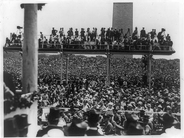 [Photographers on platform above crowd at Charles A. Lindbergh speech at the Washington Monument in Washington, D.C.]