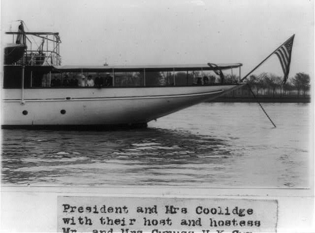 """President and Mrs. Coolidge with their host and hostess, Cyruss [i.e. Cyrus] H.K. Curtis, and other guests who attended the luncheon given on the Curtis yacht, """"Lydonia,"""" which is anchored off Haines [i.e. Hains] Point in the Potomac River"""