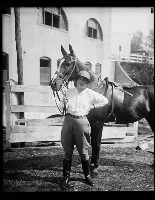 """Pretty Dorothy Fell, daughter of Mrs. Ogden L. Mills, wife of the Assistant Secretary of the Treasury, and her mount """"Dolly"""" snapped at the opening of the Washington Horse Show today. She is expected to capture a blue ribbon with this horse"""