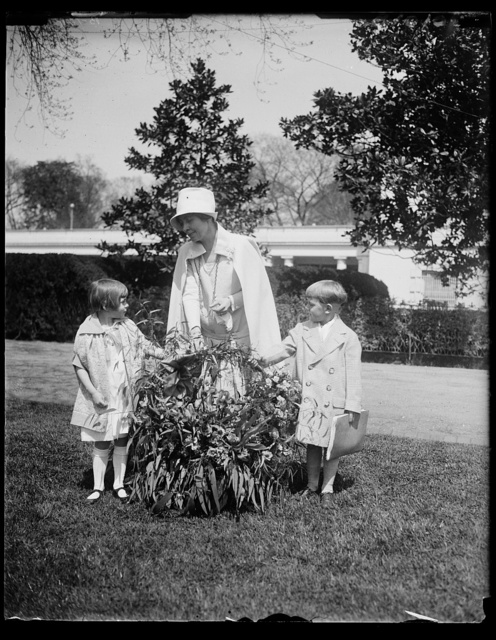 "Salvation Army children of California send Mrs. Coolidge a gift of flowers by airplane. A beautiful basket of flowers sent by airplane by the children of the Salvation Army Home at Lytton Springs, California, was presented to Mrs. Coolidge at the White House today. Ketha Holtz, daughter of Staff-Captain Ernest R. Holtz, Potomac Divisional Commander of the Salvation Army in Washington and Robert Rose, son of Ensign Robert Rose of Salvation Army, are shown making the presentation which also included a message reading: ""Dear Mrs Coolidge: We are sending you these flowers because we love you"""