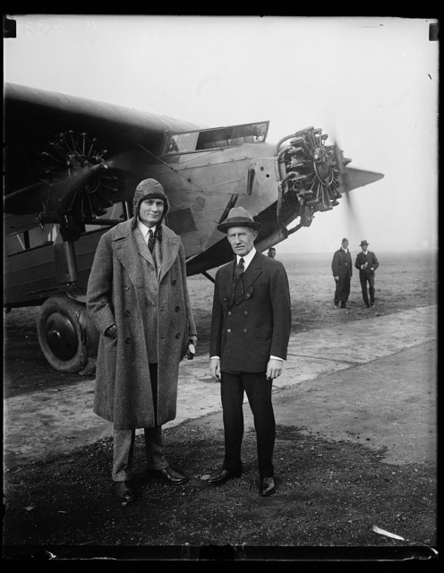 """""""The Flying Senators,"""" Senator Frederick Hale of Maine, left, and Senator Hiram Bingham of Connecticut are called the """"flying senators"""" on Capitol Hill because of their frequent use of the airplane to transact government business. This photograph was snapped at Bolling Field Washington, just before the Senators took off for Langley Field, Va. Senator Bingham is an experienced pilot, having seen service with the Army Air Service during the World War"""
