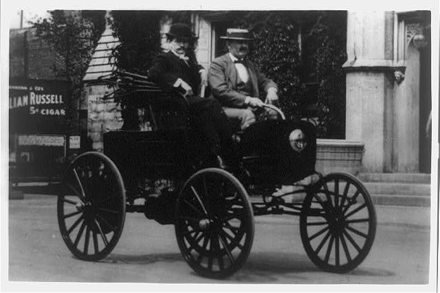 [Two men in the first American automobile, 1890's]