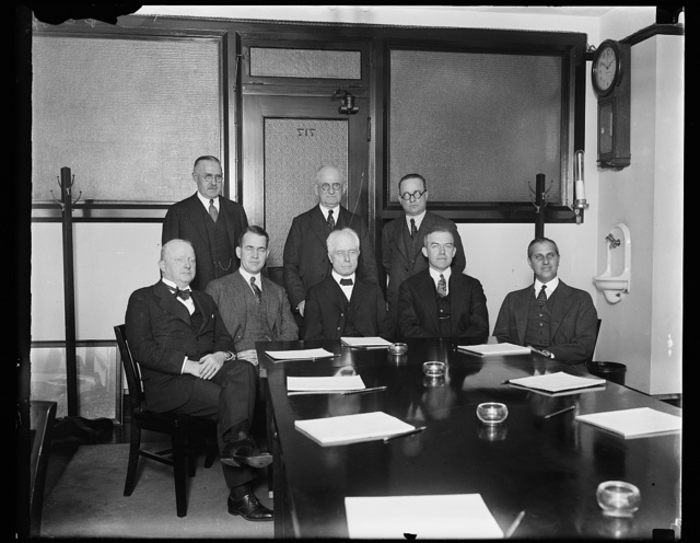 American delegation to International Civil Aeronautics Conference. The first meeting of the American delegation to the International Civil Aeronautics Conference to be held in Washington, December 12, 13, and 14, took place today in the offices of Secretary of Commerce William F. Whiting, chairman of the delegation. In the photograph, left to right: (sitting) Nelson T. Johnson, Assistant Secretary of State; Edward P. Warner, Assistant Secretary of Navy; Wm. F. Whiting, Secretary of Commerce; [...]m. P. MacCracken, Assistant Secretary of Commerce; ...nd Harry F. Guggenheim, president of Guggenheim fund for promotion of aeronautics. Standing left to right: Lester D. Gardner, president Aeronautical Chamber of Commerce; Joseph S. Ames, Chairman, National Advisory Committee for Aeronautics; and W.I. Glover, Assistant Postmaster General