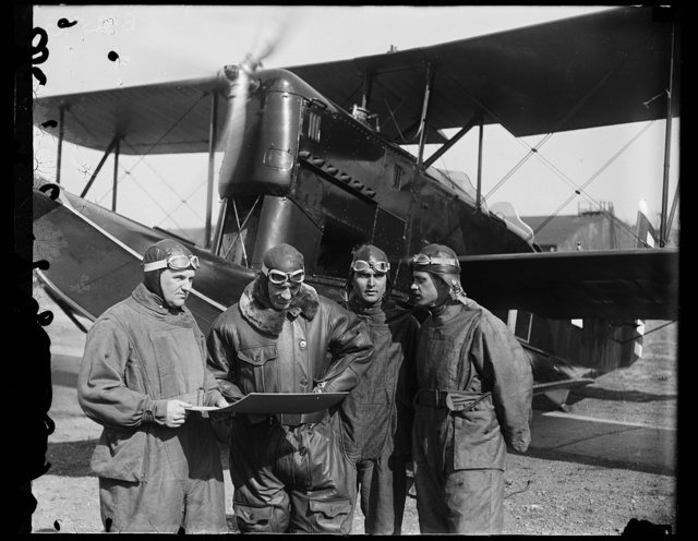 Assistant Secretary of War completes final plans with pilots for long air trip to Panama. Final plans were completed at Bolling Field, Washington, today for Assistant Secretary of War F. Trubee Davison, who will start on his long flight to Panama at daylight Sunday, March 11th. In the photograph, to right: Secretary Davison; Maj. Gen. James E. [...]et, Chief of Army Air Corps, who will accompany him; [...]ain Ira C. Eaker and Lieut. Muir S. Fairchild, who [...] pilot the planes