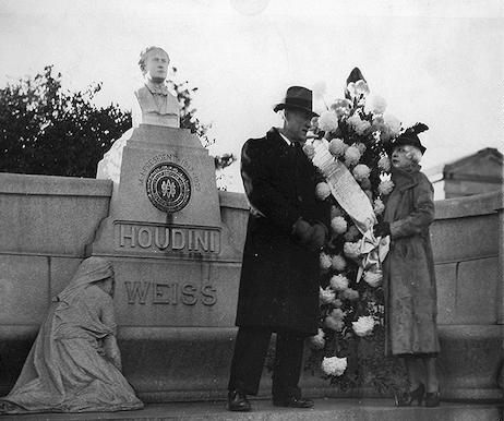 [Beatrice Houdini and Theodore Hardeen visit Houdini's grave]