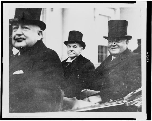 [Calvin Coolidge, Herbert Hoover, and an unidentified man, driver(?), in an automobile]
