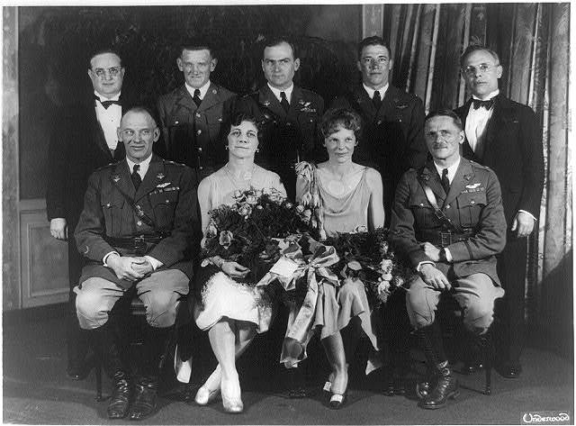 [Carl Spaatz and Amelia Earhart posed with seven other people]