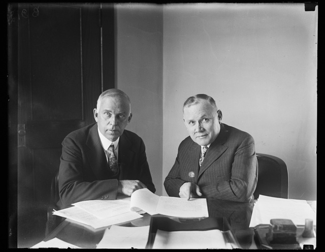 Discussing nationwide campaign for the prevention of blindness. Lewis H. Carris, (left) Managing Director of the National Society for the Prevention of Blindness, and William Green, President of the American Federation of Labor, discussing the nationwide campaign for the prevention of blindness and conservation of vision among American workmen and their families which is to be undertaken immediately as a joint effort of their respective organizations