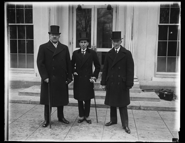 Distinguished Canadians received by President Coolidge at White House. Interesting callers at the White House today were the Minister of Justice of Canada Hon. Ernest Lapointe (left) and the Prime Minister of Quebec Hon. A. Taschereau (right) The Minister from Canada to the United States Hon. Vincent Massey is in center