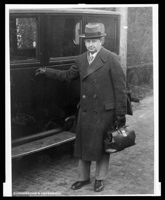 [George C. Calver, full-length portrait, carrying medical bag, about to enter automobile]