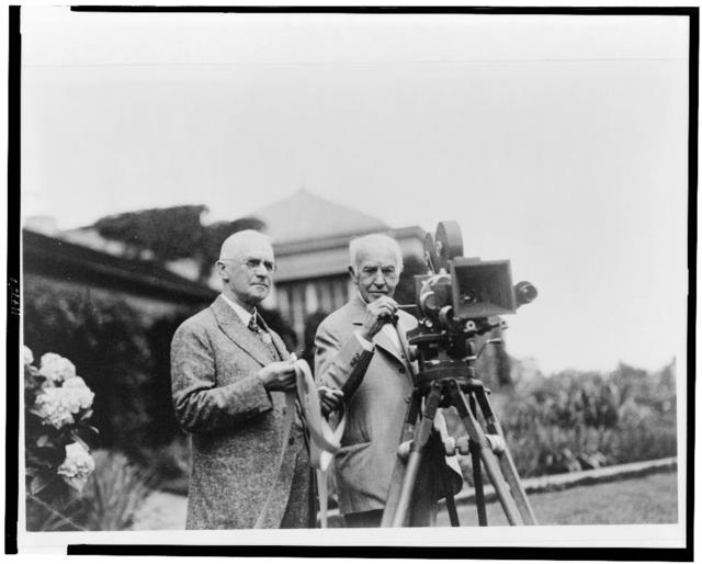 [George Eastman (left) and Thomas Edison with motion picture camera at Eastman's house in Rochester, New York, where a  demonstration of the new Kodacolor film was being held]