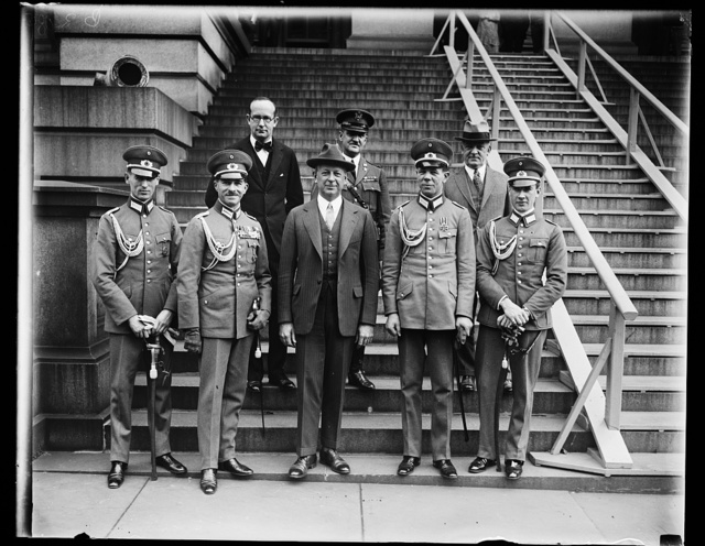 German cavalry horse show team received by Secretary of War Davis. Members of the German cavalry horse show team, one of the five foreign teams to compete with the United States in the 1928 National Horse Show just ended in New York City and the first German horse show team to come to the United States since the World War, were received by Secretary of War Dwight F. Davis today. In the front row, left to right: Lieut. Wilhelm Schmalz; Lieut. Col. von Flotow; Secretary Davis; Lieut. Baron von Nagel and Lieut. von Barnekow. In the back row, left to right: Dr. Rudolf Leitner, first secretary of the German Embassy; Col. R.H. Williams; and Maj. Gen. Bryant Wells, Deputy Chief of Staff