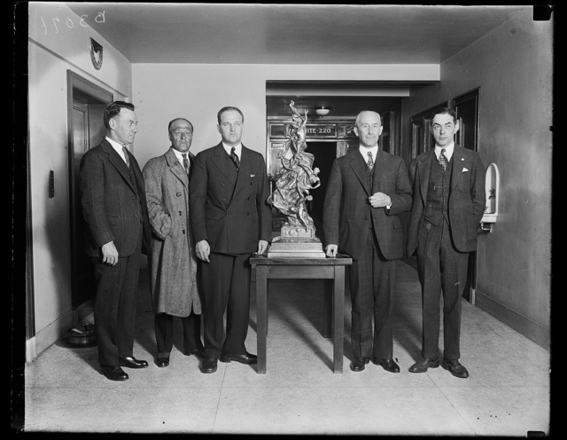 Gordon Bennett International Balloon Trophy goes to U.S. Army Air Corps. The Gordon Bennett International Balloon Trophy, property of the National Aeronautic Association by virtue of three victories by American Balloonists, was today presented to Assistant Secretary of War for Aviation F. Trubee Davison for the Army Air Corps for a year by Orville Wright, secretary of the Contest Committee of the Association An Army pilot, Captain W.G. Kemper, secured the trophy for America by winning the race from Detroit last year. In the photograph, left to right: Ray Cooper, of the National Aeronautic Association, who brought the trophy to Washington by airplane from Michigan; Brig. Gen. Benjamin Foulois, Assistant Chief of the Army Air Corps; Secretary F. Trubee Davison; Orville Wright; and Porter Adams, president of the National Aeronautic Association