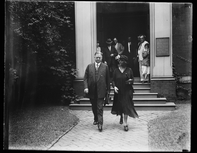 [Herbert and Lou Hoover leaving Friends Meeting House]