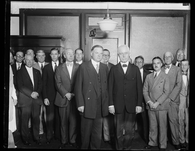 [Herbert Hoover and William F. Whiting with group]
