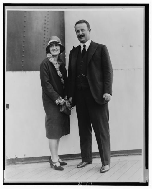 [Kermit Roosevelt and his wife Belle, both full-length, standing]