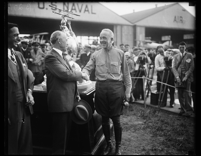 Orville Wright congratulates Marine Corps flyer on winning Curtiss Marines Trophy. Orville Wright (left), pioneer airman, congratulating Maj. C.A. Lutz, United States Marine Corps flyer, who won the Curtiss Marine Trophy in Washington today. Maj. Lutz averaged 157 miles an hour