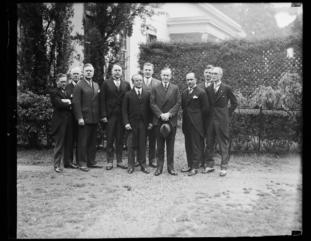 President Coolidge is invited to fly over Washington. Russ Halley, banker and aviator of Rapid City, North Dakota, where President Coolidge spent last summer's vacation, arrived in Washington today in his 15-passenger plane. He immediately went to the White House to invite the President for a flight over the National Capital which offer was refused with thanks by the Chief executive. Senator Peter Norbeck of North Dakota is on the left